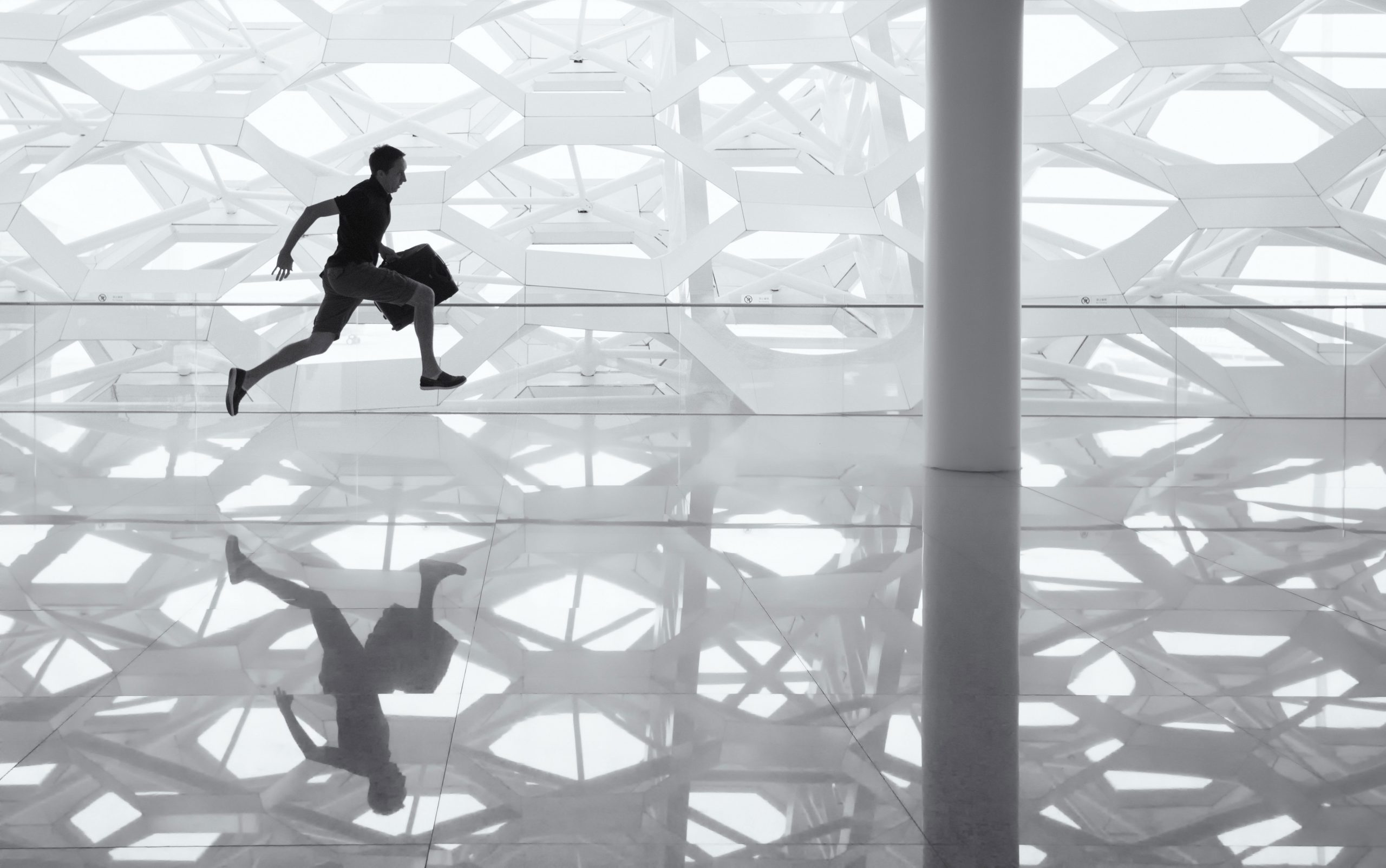 Young man running to work